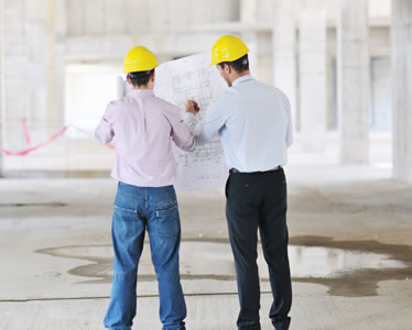 construction workers going over blueprints